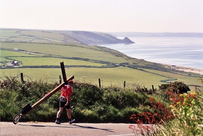 Counties evangelist Clive Cornish walks with his cross around the beautiful coast of Wales. Beach scenery near Newgale
