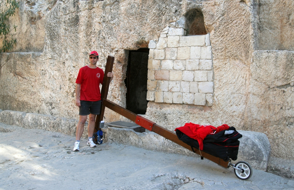 Counties evangelist Clive Cornish walks with his cross at the Garden Tomb in Jerusalem - the tomb of Jesus - during a project called From Jerusalem to Rome in the Footsteps of the Apostle Paul.