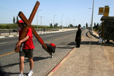 A Jewish gentleman watches the cross pass by. The cross is carried by Counties evangelist Clive Cornish through Israel during a project called From Jerusalem to Rome in the Footsteps of the Apostle Paul.