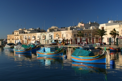 Local fishing boats in Malta in a traditional Maltese harbour photographed during a project called From Jerusalem to Rome in the Footsteps of the Apostle Paul.