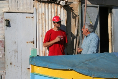 Counties evangelist Clive Cornish talks with a fisherman in Malta during a project called From Jerusalem to Rome in the Footsteps of the Apostle Paul.