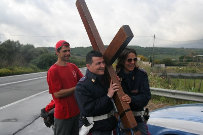 Local police talk and carry Counties evangelist Clive Cornish's cross as he walks through Sicily - photographed during a project called From Jerusalem to Rome in the Footsteps of the Apostle Paul.