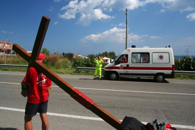 Counties evangelist Clive Cornish talks with a local ambulance crew while walking through Sicily with his cross - photographed during a project called From Jerusalem to Rome in the Footsteps of the Apostle Paul.