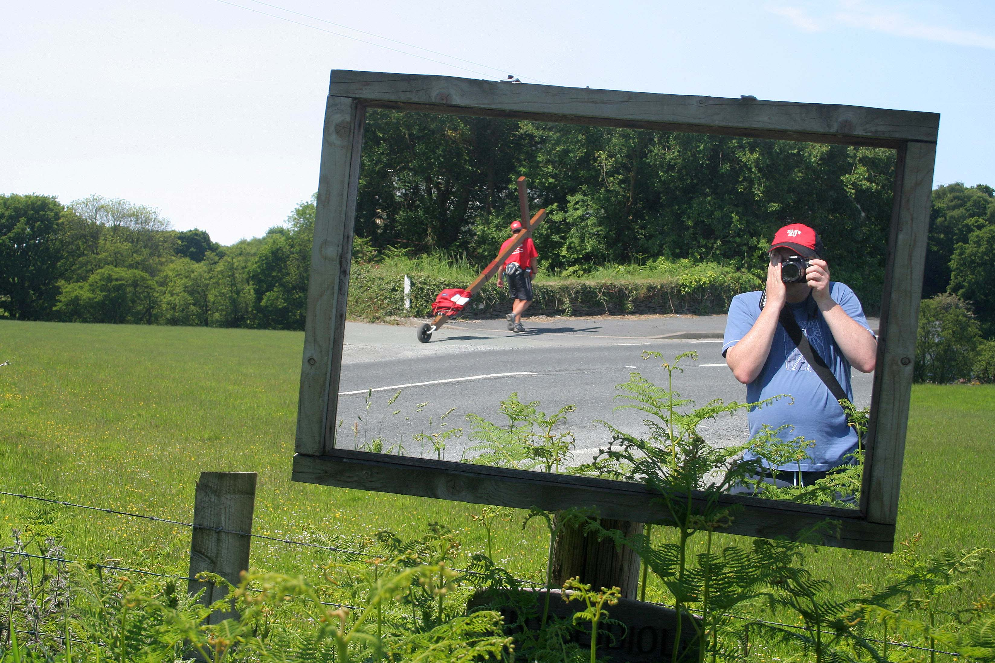 Counties evangelist Clive Cornish captured walking his cross in a roadside mirror - somewhere in mid-Wales