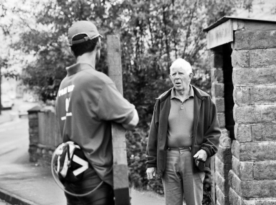 Counties evangelist Clive Cornish discusses Christianity and faith with a man at a bus stop