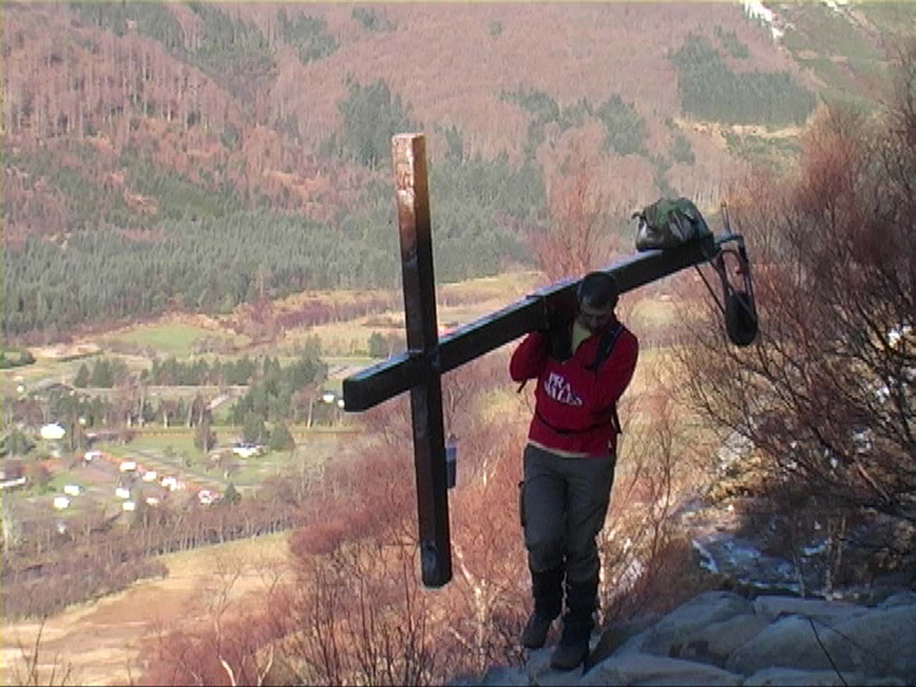 Counties evangelist Clive Cornish ascends Ben Nevis from Glen Nevis carrying a wooden cross, just before meeting the path from Fort William
