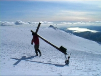 Counties evangelsit approaches the summit of Ben Nevis after a gruelling climb in snow with his cross