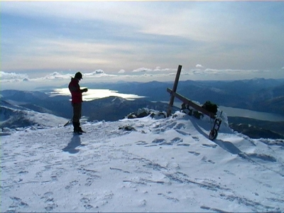Counties evangelist stops with his cross near the snowy summit of Ben Nevis and enjoys a sweeping mountain view