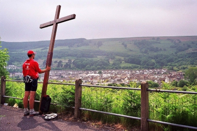 Counties evangelist Clive Cornish raises his cross above the Valleys of South Wales and prays for the villagers.