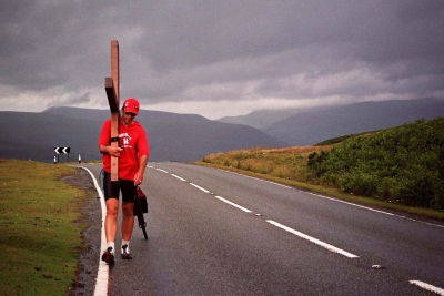 Counties evangelist Clive Cornish walks with a cross through the Brecon Beacons - a new style of evangelism