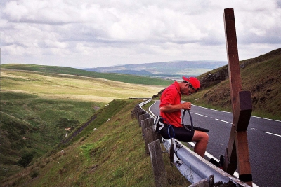 Counties evangelist Clive Cornish repairs the wheel of his cross during a hard day walking through the Brecon Beacons in South Wales - 1