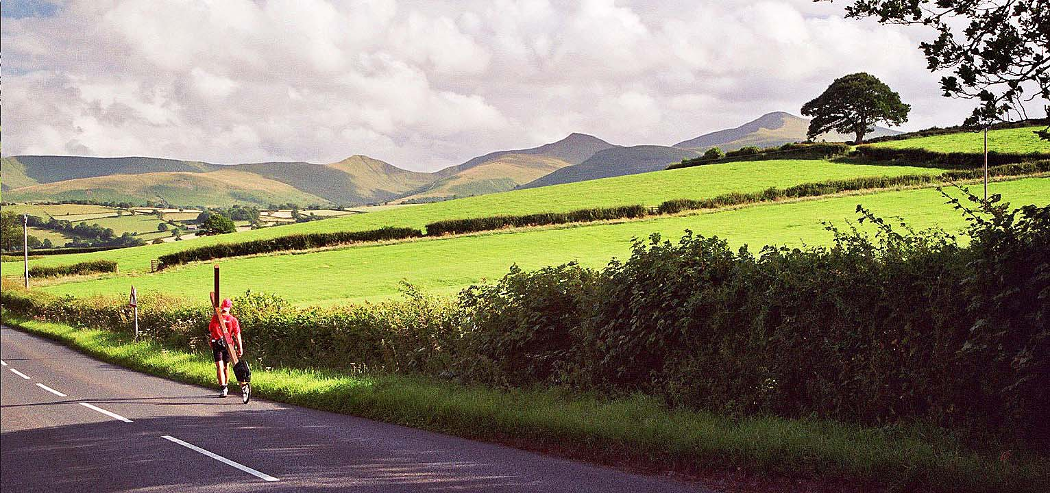 Counties evangelist Clive Cornish walks towards the Brecon Beacons in South Wales. Pen y Fan is southern Britain's highest mountain
