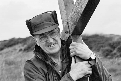 A man carries Counties evangelist Clive Cornish's cross in the north of Scotland - the start of the walk from John O Groat's to Land's End