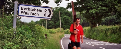 Counties evangelist Clive Cornish carries his cross past a signpost to Bethlehem in Wales during a Pray Wales walk