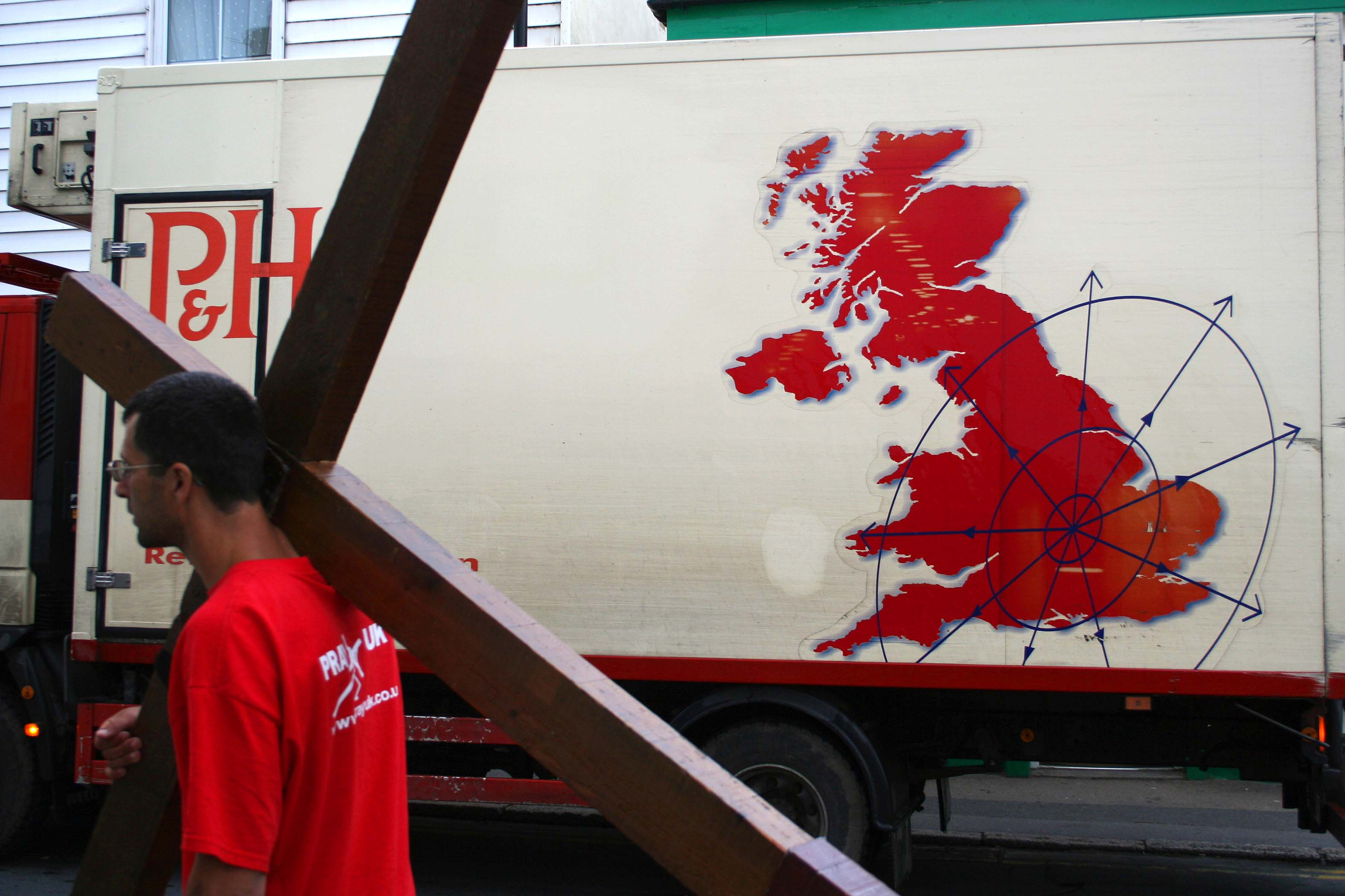 Counties evangelist Clive Cornish carries his cross past a van showing a map of the UK. The photograph was taken by Lathan Ball as they walked from John O'Groats to Land's End.