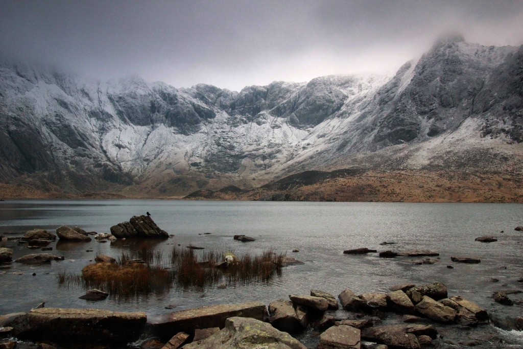Llyn Idwal sits in a spectacular ice carved hollow known as Cwm Idwal and reflects the brooding Devil's Kitchen